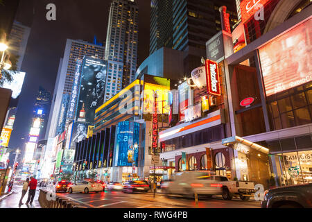 NEW YORK, USA - SEPTEMBER 20, 2013: night street broadway in new york . Yellow taxi, many people and advertising outdoor - Stock Photo
