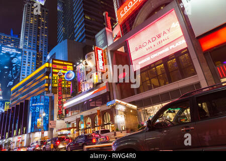 NEW YORK, USA - SEPTEMBER 20, 2013: night street broadway in new york .  taxi close-up, many people and advertising outdoor - Stock Photo