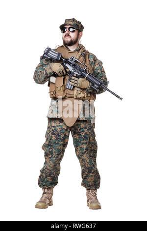 Studio shot of U.S. Marine in uniform, equipped with rifle. - Stock Photo