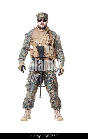 Studio shot of U.S. Marine in uniform, equipped with rifle - Stock Photo