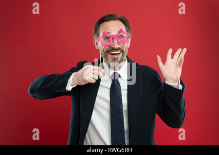 Cheerful businessman in party photo booth props. Guy enjoying party carnival. Holiday party celebration. Having fun. Office party corporate. Join carnival. Man formal suit wear fake glasses accessory. - Stock Photo