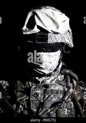 Shoulder portrait of Army soldier in combat helmet. - Stock Photo