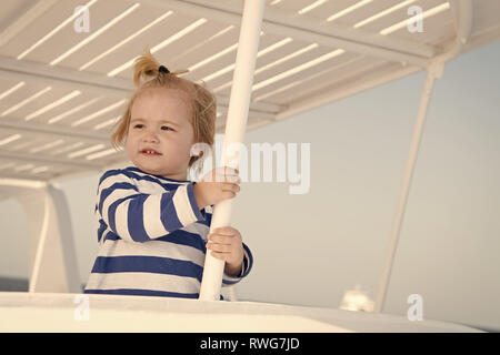 Cruising with kids. Child smiling face striped shirt looks like sailor. Kid boy toddler travelling sea cruise. Family vacation on cruise ship all inclusive tour. Child enjoy vacation on cruise ship. - Stock Photo