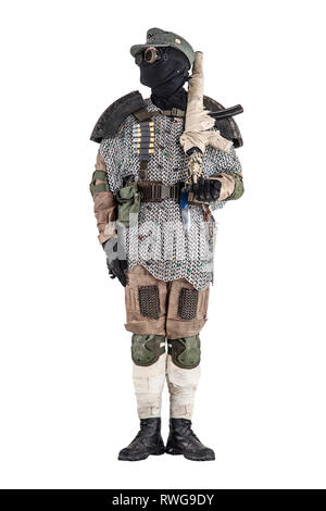 Post apocalyptic soldier wearing handmade armor, standing at attention. - Stock Photo