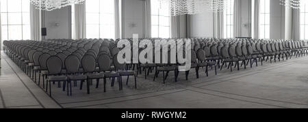 Empty conference hall. Empty rows of chairs - Stock Photo