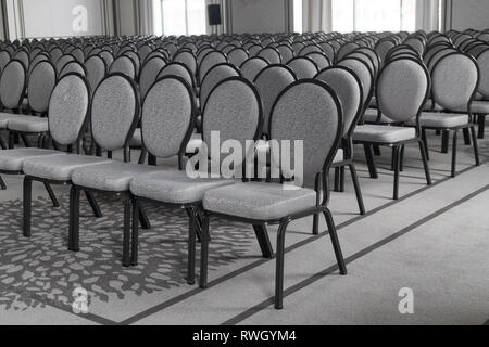 Empty conference hall. Empty rows of chairs. Monochrome - Stock Photo