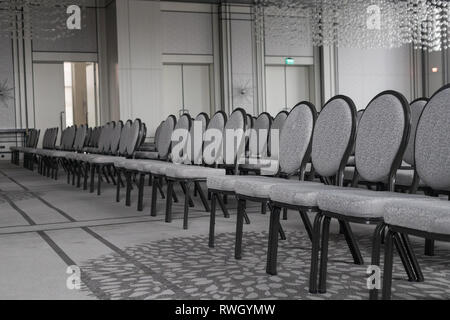 Empty conference hall. Straight rows of chairs. Monochrome - Stock Photo