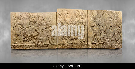 Hittite sculpted orthostats panels of Long Wall Limestone, Karkamıs, (Kargamıs), Carchemish (Karkemish), 900-700 B.C. Soldiers. Anatolian Civilisation - Stock Photo