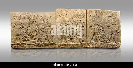 Picture & image of Hittite sculpted orthostats panels of Long Wall Limestone, Karkamıs, (Kargamıs), Carchemish (Karkemish), 900-700 B.C. Soldiers. Ana - Stock Photo