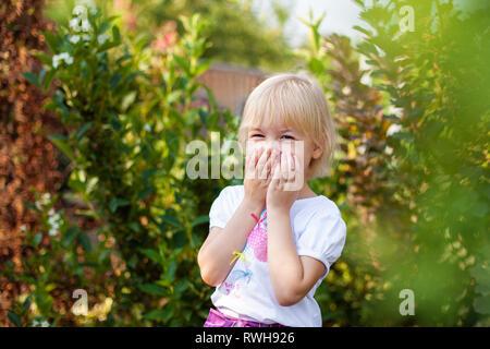Closeup portrait of happy little blobde girl in elementary school