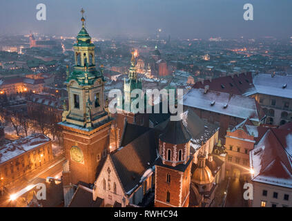 Aerial view of the historical center of Krakow, church, Wawel Royal Castle at night. Old town in winter - Stock Photo