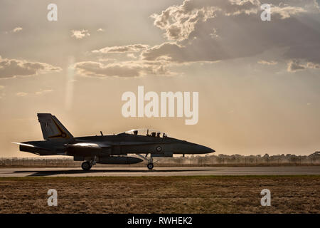 F/A-18A/B Hornet, Royal Australian Air Force taxiing against against a sunlit sky - Stock Photo