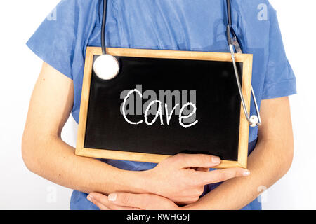 Doctor shows information on blackboard: care.  Medical concept. - Stock Photo