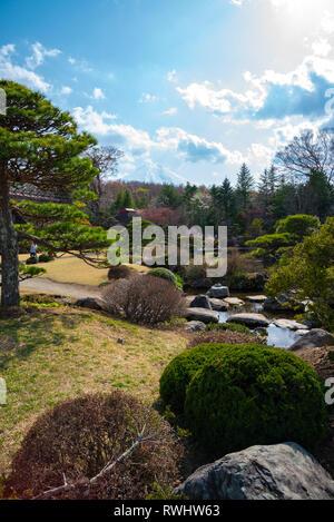 Traditional house, spring garden at ancient Oshino Hakkai village near Mt. Fuji, Fuji Five Lake region, Minamitsuru District, Yamanashi Prefecture, Ja - Stock Photo
