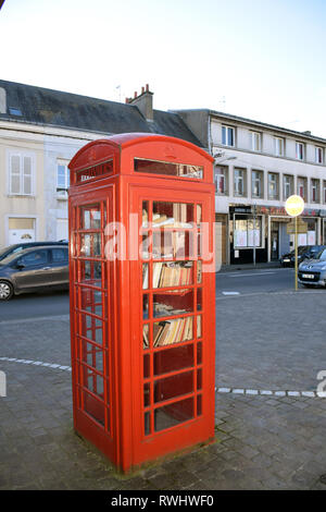 Pithiviers in France is twinned with Ashby-de-la-Zouch in England. Donated red telephone box converted into a book swap library. Feb 2019 - Stock Photo