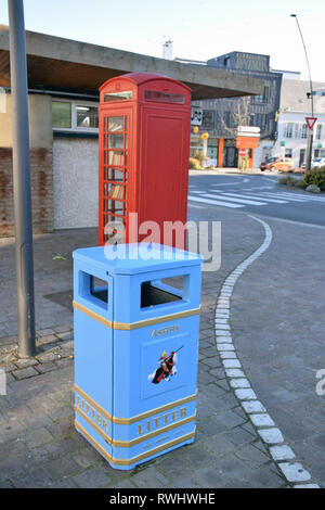 Pithiviers in France is twinned with Ashby-de-la-Zouch in England. Donated blue litter bin and red telephone box that has been converted into a book s - Stock Photo