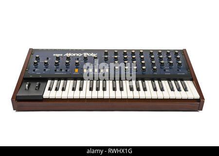 Korg Monopoly vintage analog synthesizer from 1981 and white studio background. - Stock Photo