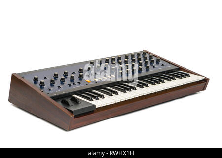 Korg Monopoly vintage analog synthesizer from 1981 and white studio background. Logo and branding removed. - Stock Photo