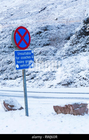 No stopping clearway & unsuitable for coaches and heavy goods vehicles road signs on A82 road on a cold winter day at Rannoch Moor, Argyll, Scotland - Stock Photo