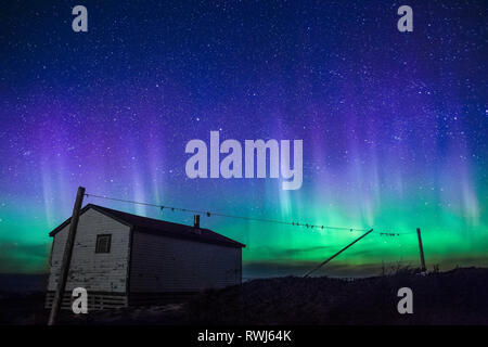 Stars & Northern Lights Aurora Borealis over Broom Point, Gros Morne National Park, Newfoundland and Labrador - Stock Photo