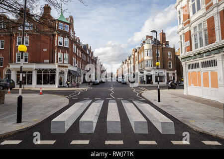 3D Zebra Crossing painted on a north-west London road in a bid to slow down the traffic and improve pedestrian safety - Stock Photo
