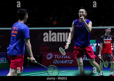 Birmingham. 6th Mar, 2019. China's Liu Cheng/Zhang Nan (front R) celebrate during the men's doubles first round match with Indonesia's Marcus Fernaldi Gideon/Kevin Sanjaya Sukamuljo at the All England Open Badminton Championships 2019 in Birmingham, Britain on March 6, 2019. Credit: Tang Shi/Xinhua/Alamy Live News - Stock Photo