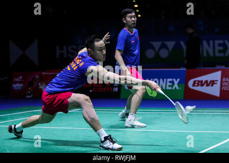 Birmingham. 6th Mar, 2019. China's Liu Cheng/Zhang Nan (front) compete during the men's doubles first round match with Indonesia's Marcus Fernaldi Gideon/Kevin Sanjaya Sukamuljo at the All England Open Badminton Championships 2019 in Birmingham, Britain on March 6, 2019. Credit: Tang Shi/Xinhua/Alamy Live News - Stock Photo
