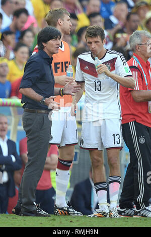 Federal coach Joachim Jogi LOEW, LOW (GER) and Thomas MUELLER. Archive photo: Federal coach Joachim Jogi LOEW, L, AOW (GER) with Thomas MUELLER (M, AULLER) (GER). France (FRA) -Germany (GER) 0-1. Quarterfinals, 3rd round, Game 58, on 04.07.2014 in Rio De Janeiro. Football World Cup 2014 in Brazil from 12.06. - 13.07.2014. ¬ | usage worldwide - Stock Photo