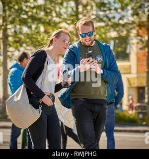 Taking pictures with a smartphone, Reykjavik Festival, Iceland - Stock Photo