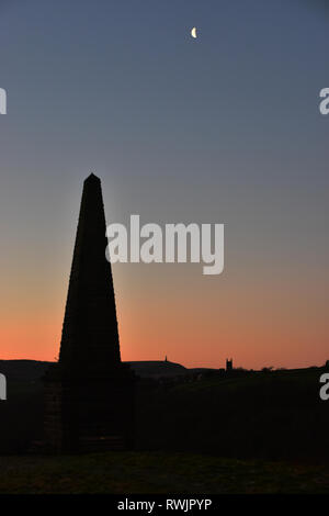 The Triumvirate, Smeekin Pike, Heptonstall Church, Stoodley Pike, under the moon and silhouetted by sunrise, Hebden Bridge, Calderdale, West Yorkshire - Stock Photo