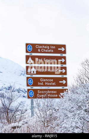Directions road signs in Glencoe on a cold winter day with snow at Rannoch Moor, Glencoe, Argyll, Scotland - Stock Photo