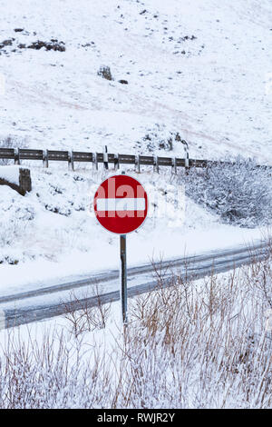 no entry road sign on a cold winter morning with snow at Rannoch Moor, Glencoe, Argyll, Scotland - Stock Photo