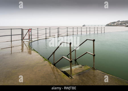 The Marine Lake at Clevedon with the Victorian pier in the Severn Estuary beyond. North Somerset, England. - Stock Photo