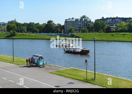 Krakow, Poland - August 12 2018: Vistula (Wisla) river banks with people relaxing - Stock Photo