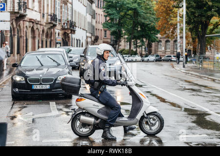 Strasbourg, France - Sep 12, 2017: Young caucasian French police officer blocking street on a rainy day during protest  - Stock Photo
