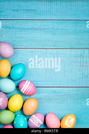 Colorful Easter Eggs arranged on a blue background. - Stock Photo