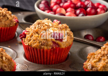 Freshly baked cranberry muffins with oatmeal crumble topping - Stock Photo