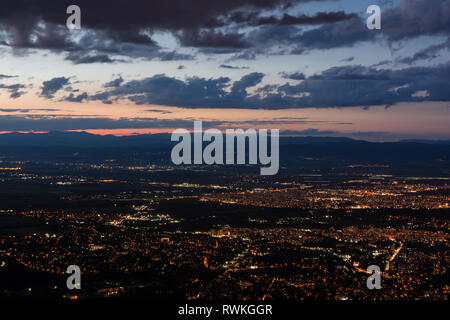 View to the Sofia city at dusk. View from the Kopitoto Hill, Vitosha Mountain, Bulgaria. - Stock Photo