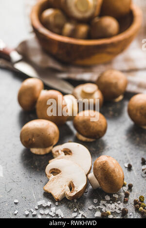 Fresh sliced champignon mushrooms on kitchen table. - Stock Photo