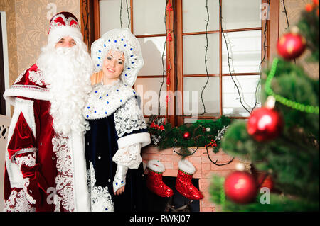 Russian Christmas characters: Ded Moroz Father Frost and Snegurochka Snow Maiden. - Stock Photo