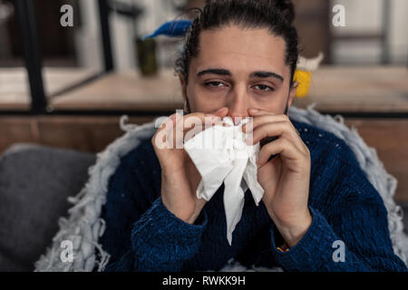 Portrait of a sad sick young man - Stock Photo
