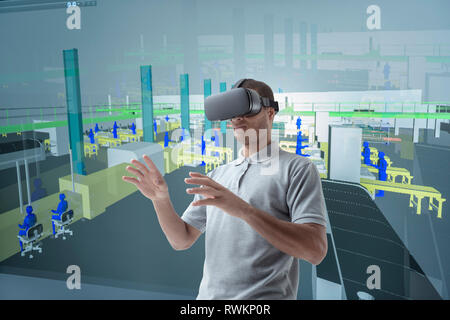 Composite image of engineer using virtual reality headset in VR suite - Stock Photo
