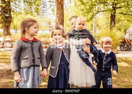 Girls, boy and baby boy in park, portrait - Stock Photo