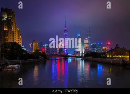 Pudong skyline and Waibaidu Bridge over Huangpu river  at night, Shanghai, China - Stock Photo