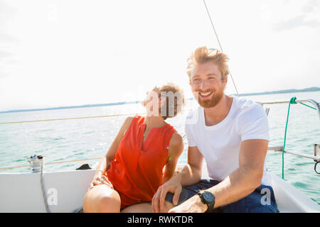 Young man and mature woman sailing on Chiemsee lake, Bavaria, Germany - Stock Photo