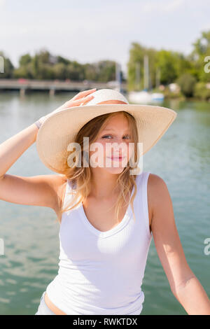 Young woman on sailboat, portrait, Chiemsee lake, Bavaria, Germany - Stock Photo