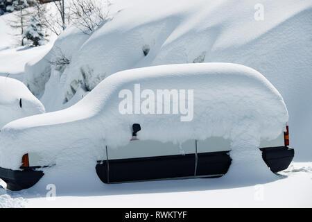Car covered in deep snow, Alpe-d'Huez, Rhone-Alpes, France - Stock Photo