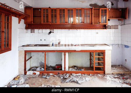 Interior of an abandoned ruin house kitchen - Stock Photo