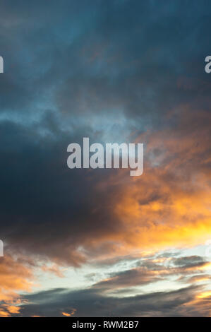 sunset with colorful stratocumulus clouds - Stock Photo