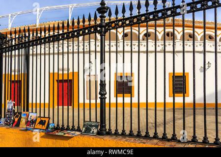 Seville, Spain - Dec 2018: Art paintings on sale as memorabilia outside Plaza de Toros de Sevilla - Stock Photo